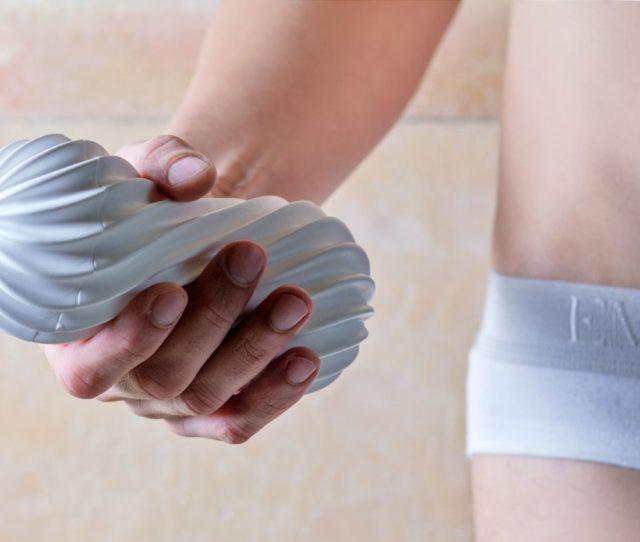 Male Hand Holding Tenga Flex Silky White Sex Toy