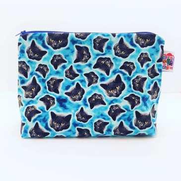 Grande trousse chats phosphorescents fond bleu