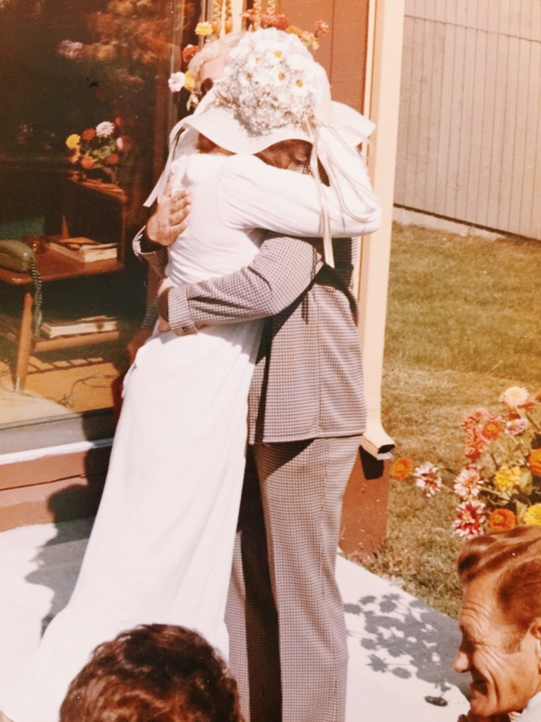 mom and dad wedding day - hugging love and marraige