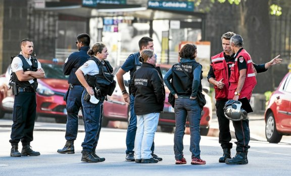 Firefighters and scientific police officers speak in front of the Saint-Pierre-et-Saint-Paul cathedral in Nantes, western France, on July 19, 2020. French investigators were on SJuly 19 questioning a...