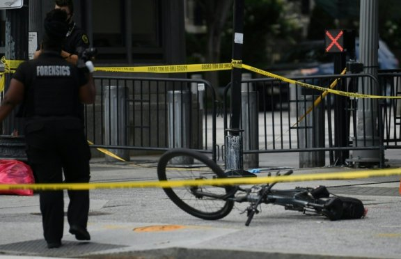A US Secret Service uniform officer's bike is seen laying on the sidewalk on Pennsylvania Aavenue near the White House in Washington, DC, on August 10, 2020. Secret Service guards shot a person, who...