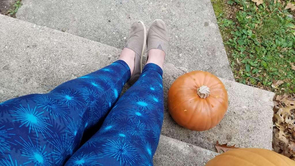 Wearing blue firework Lularoe leggings