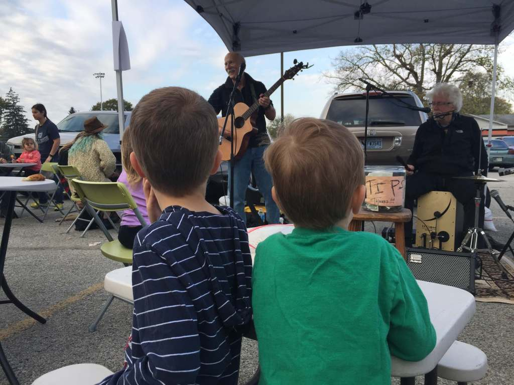 Boys watching musicians at farmers market
