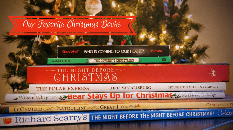 Christmas books stacked in front of tree