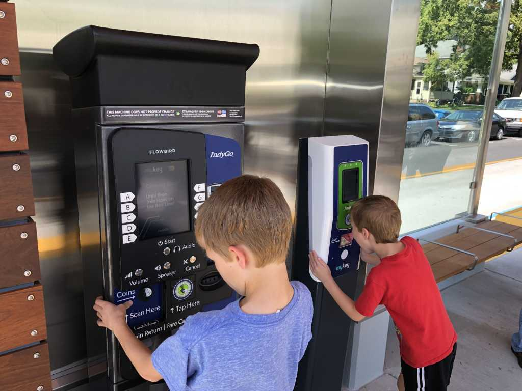 Red Line with kids - kids looking at ticket payment station