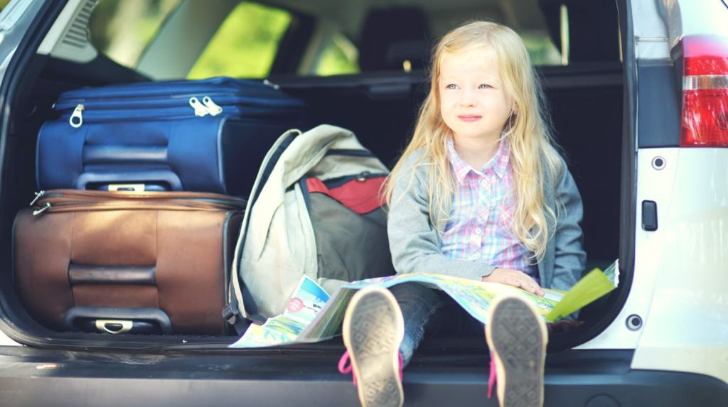 What to do when your kid hates traveling - child sitting in trunk