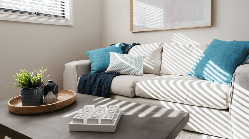 Simple Home Staging Tips - add greenery and pillows