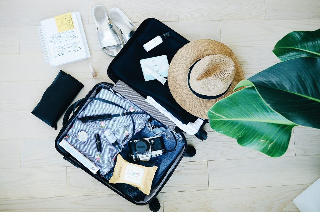 suitcase open with hat - Resource Library Sign Up Page for Let Me Give You Some Advice