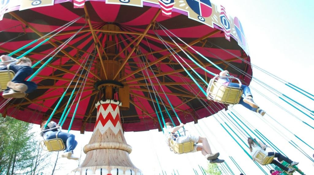Why Kids Hate Traveling - amusement park swing ride
