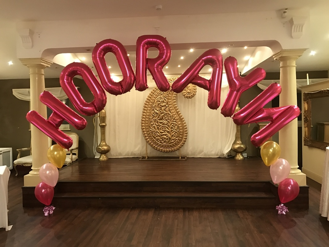 chair cover hire manchester uk wooden porch rocking chairs balloon letters and numbers at let s celebrate weddings in name arch hyde
