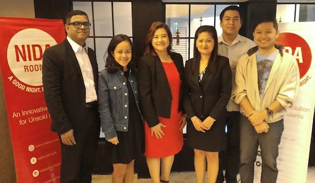 Nida Rooms Philippines Team