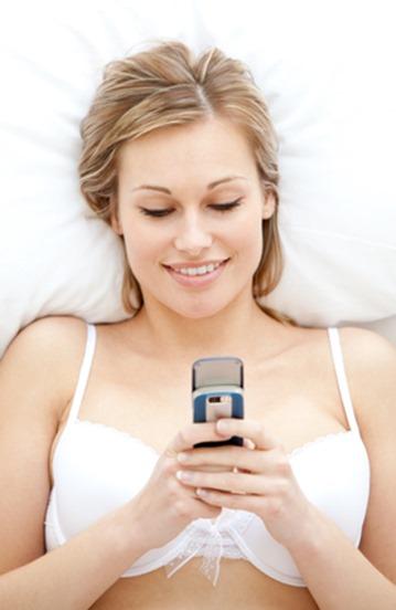 Smiling woman in underwear sending a sext