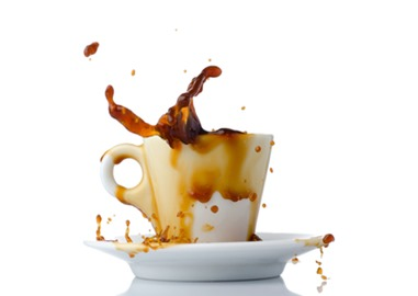 Coffee splashing out of a cup