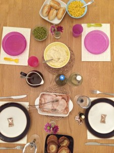 A table set for Thanksgiving dinner as a family of 4