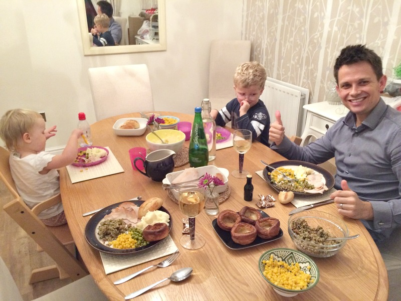 A family sat at the table for an expat Thanksgiving