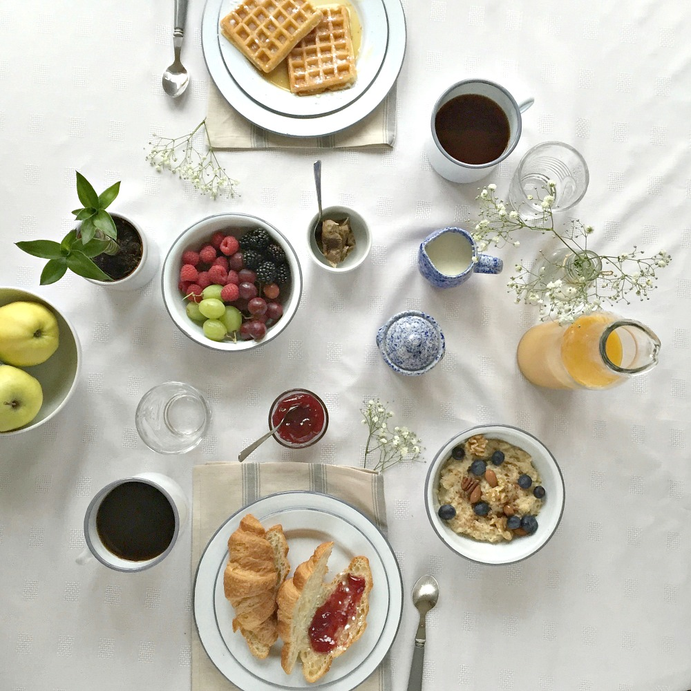 A breakfast tablescape with The Orchard's Enamel Tableware Collection