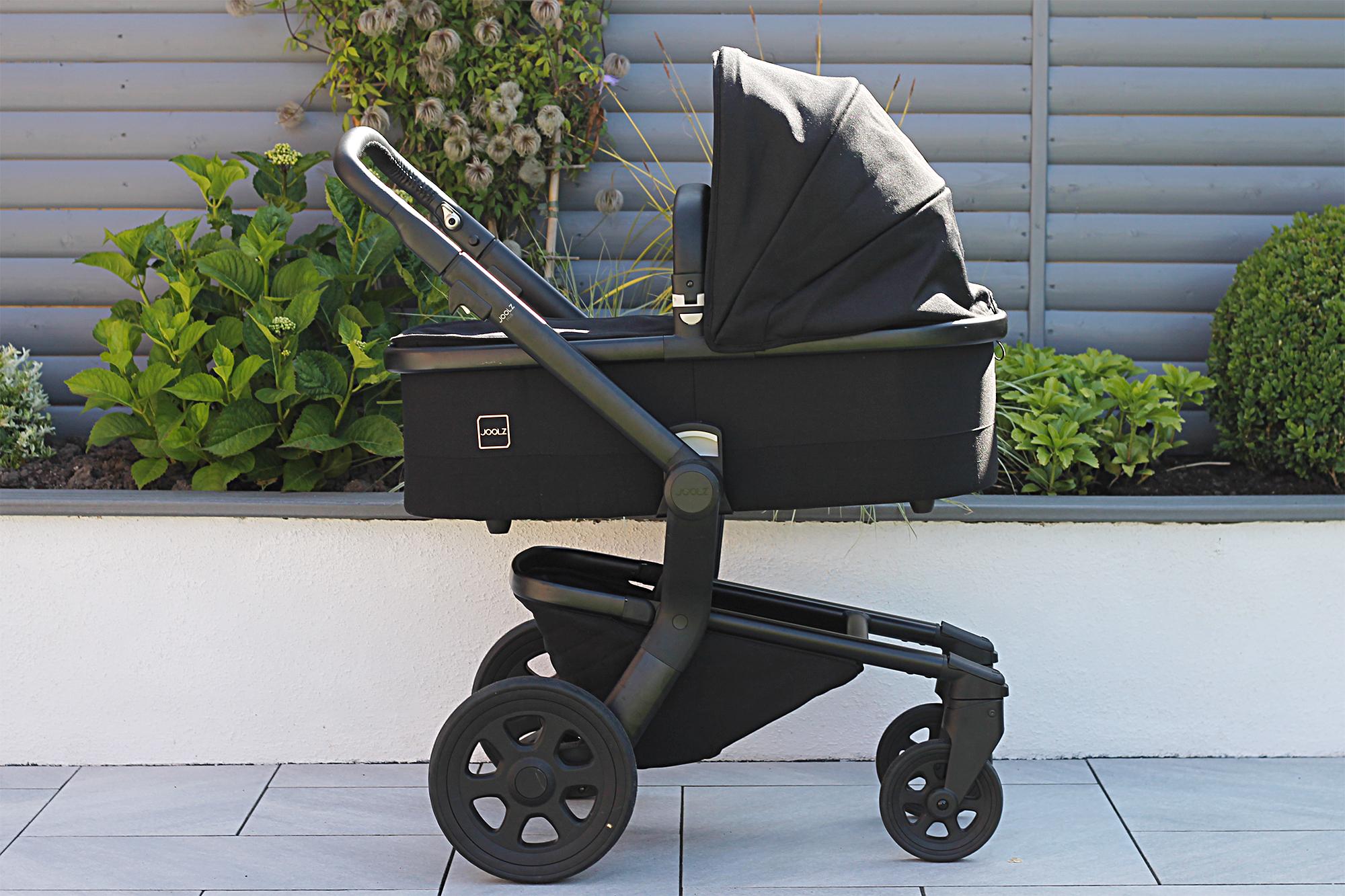 New Joolz Hub Stroller in black in a garden