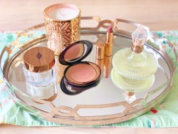 Charlotte Tilbury perfume skincare makeup cream lipstick and blush powder
