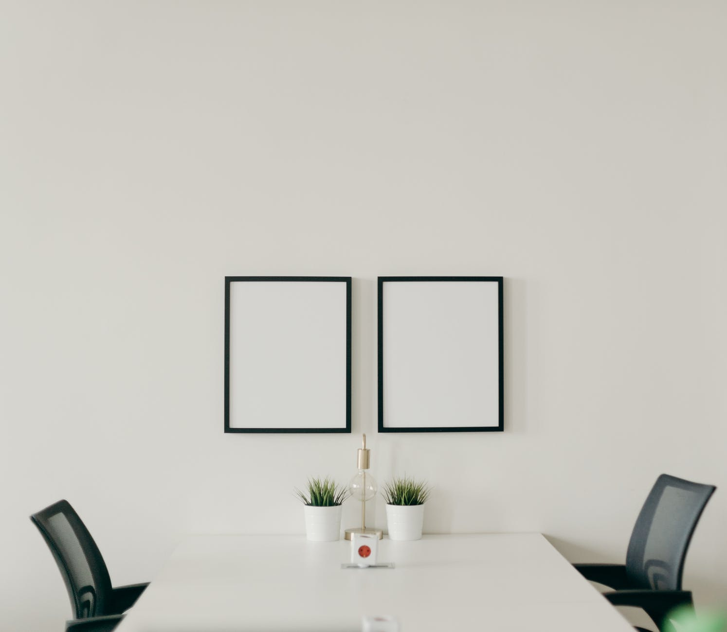 white wooden table with chairs in a room