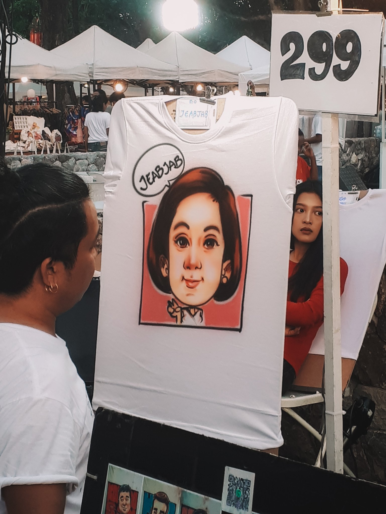 artist painting a face on a t-shirts in hua hin town thailand
