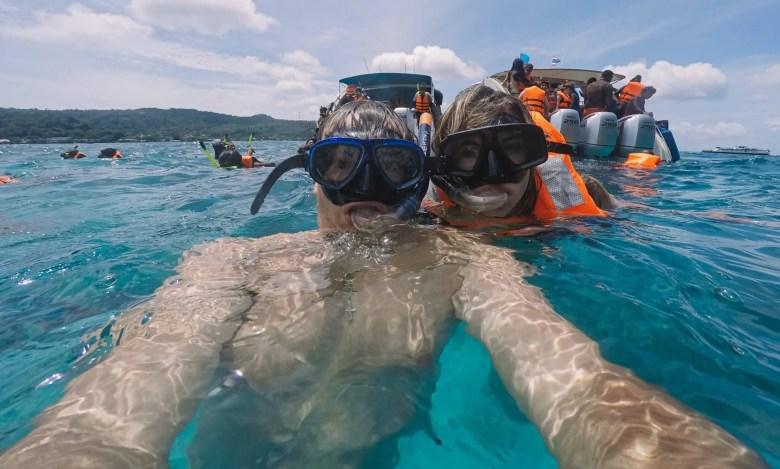 a couple enjoying a snorkeling trip close to Phi Phi islands.
