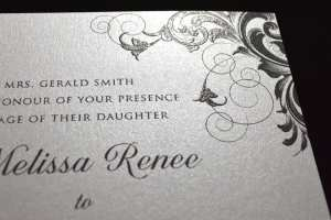 Detail of a thermography printed wedding invitation.