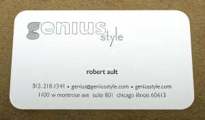 Business card with a registered emboss.