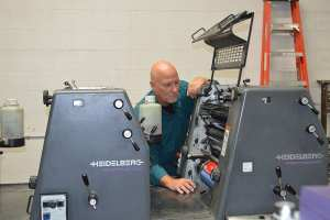 Gary, working on the five color Heidelberg offset.