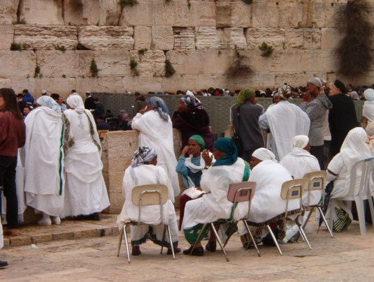 Ethiopian Israeli women at the Western Wall in their traditional white dress and colorful headscarves.