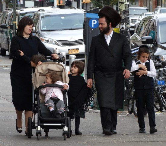 A Hassidic/haredi family in Brooklyn. By Adam Jones [CC BY-SA 2.0], via Wikimedia Commons