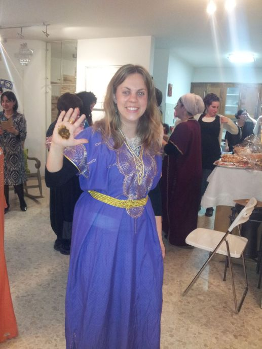 And my friend Michal, who is pure Ashkenazi, but whose brother recently married a Yemenite girl. The circle of henna on her hand is part of the ceremony, where the bride smears henna on the hands of the guests and gives them a blessing.