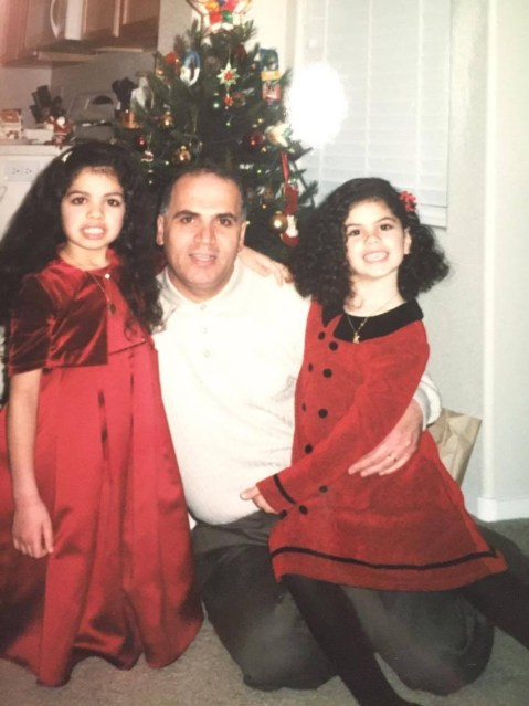 Alana's dad with her (right) and her sister