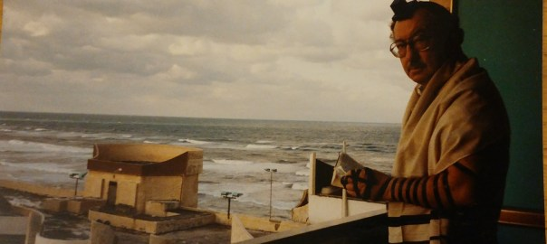 photo of Zadie praying on a balcony with the sea in the background