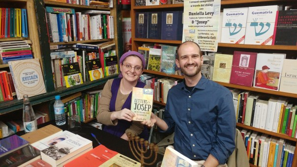 photo of Daniella and Josep in bookstore holding a copy of LtJ together
