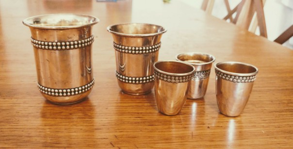 photo of five silver goblets of varying sizes