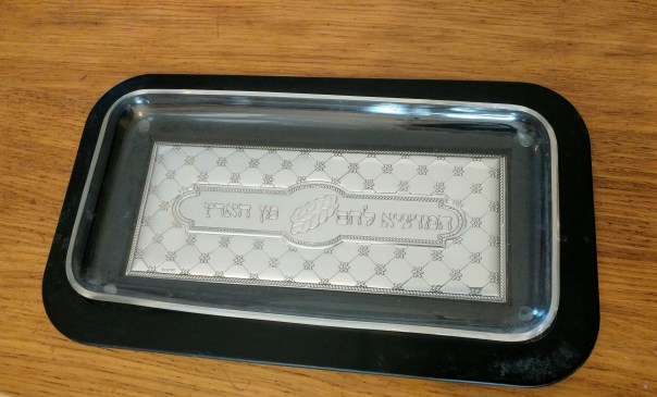 photo of tray made of wood and silver with a glass insert