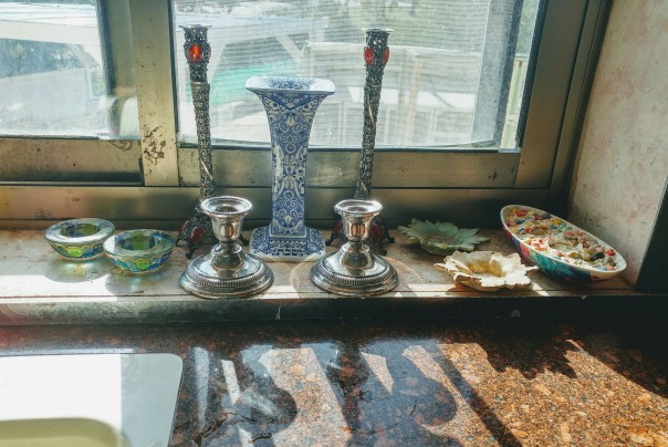 photo of candlesticks on a windowsill