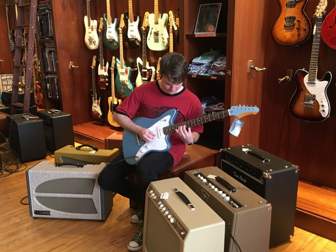 Gavin playing guitar at Rudy's Guitar Store in Soho