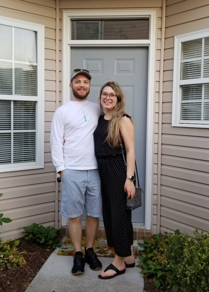 Jimmy and Bre in front of their house