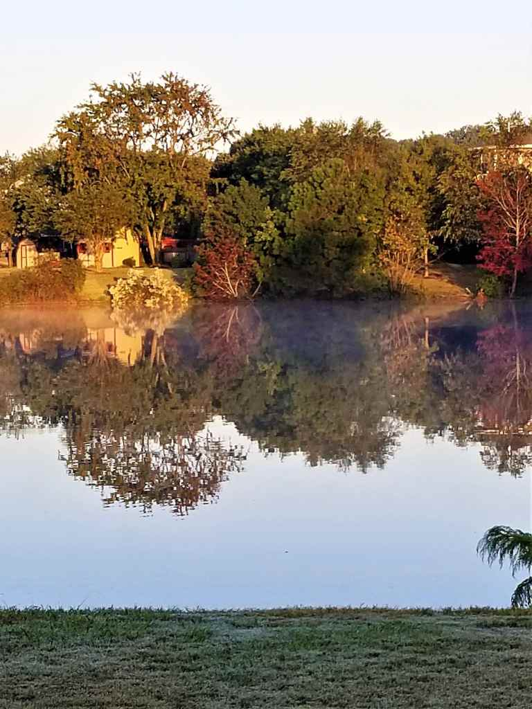 ocean lakes mirror image with a little fog