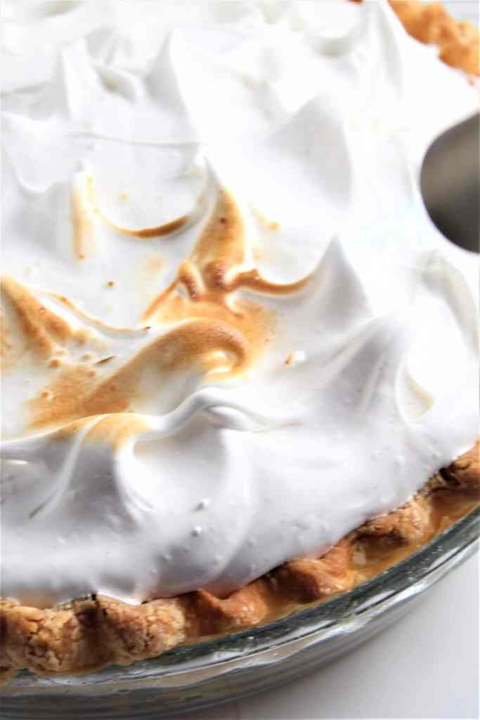 torching the marshmallow meringue on the pie