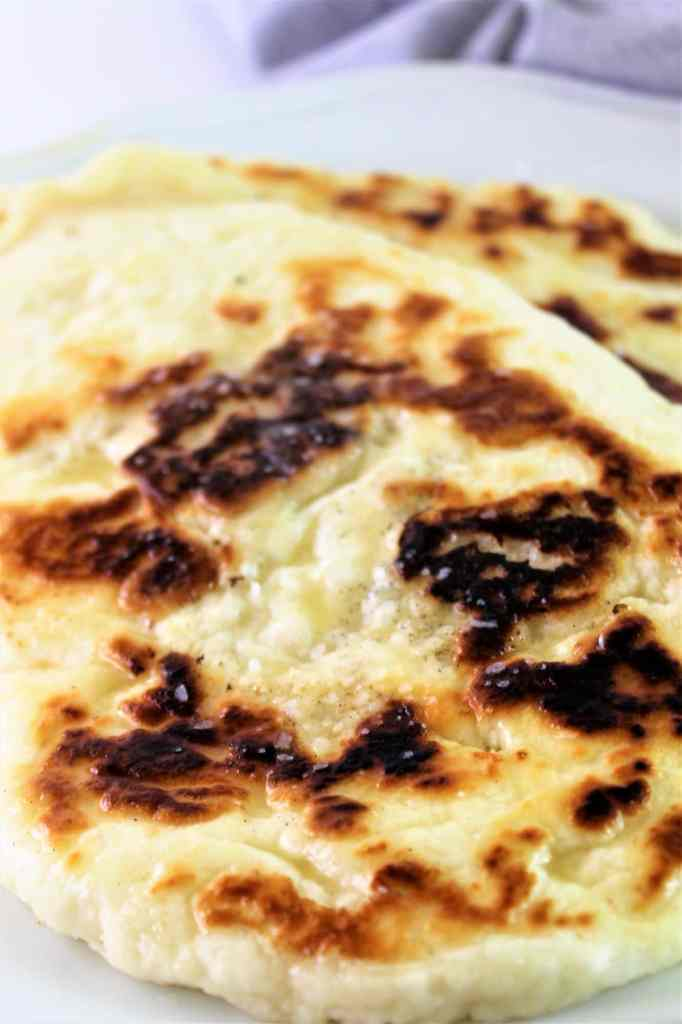 yeast free naan on a white plate