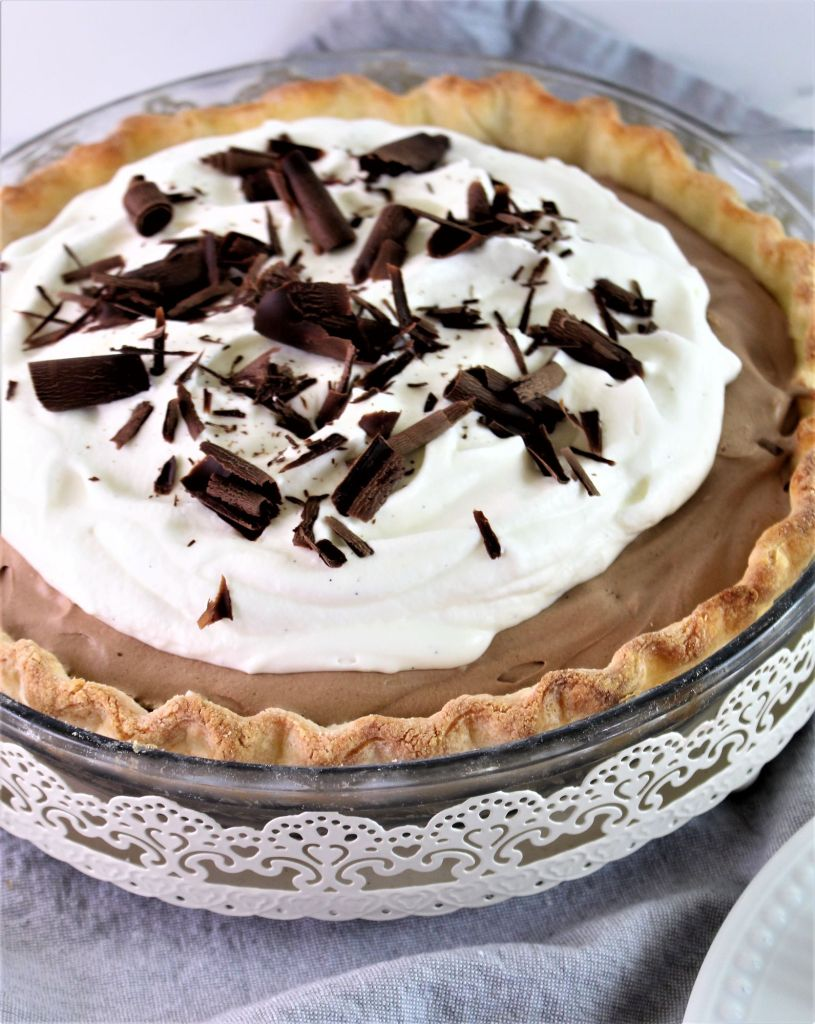 whole pie in decorative pan on grey napkin