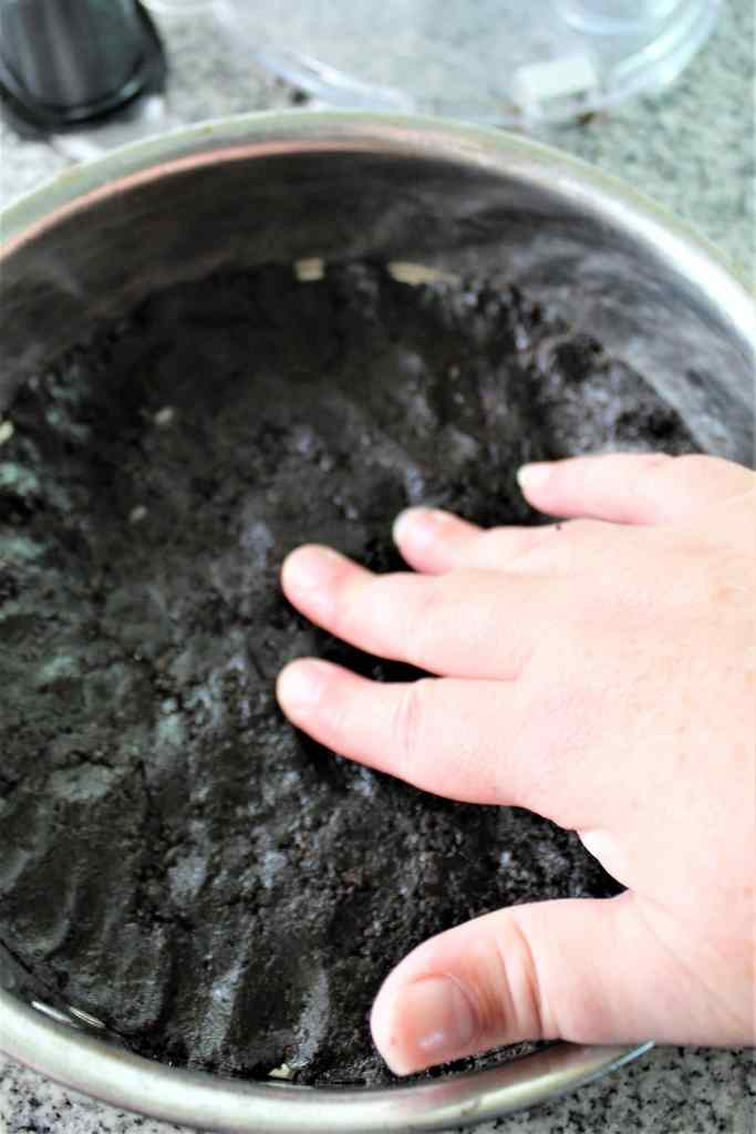 pressing crust into bottom of springform pan