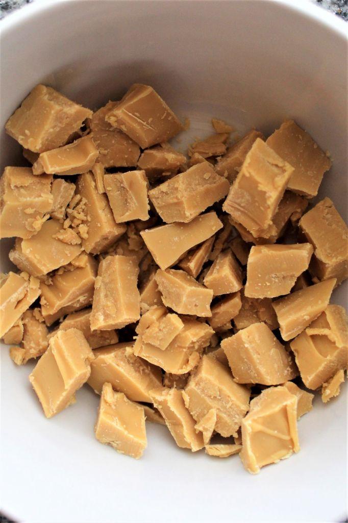 white bowl full of caramelized white chocolate chunks