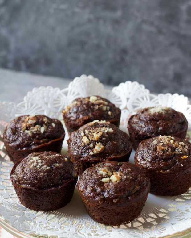 Chocolate Zucchini Muffins on plate with white doily