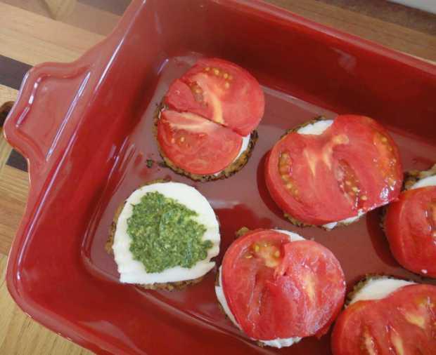 layers of Caprese Veggie Patties with Basil Arugula Pesto