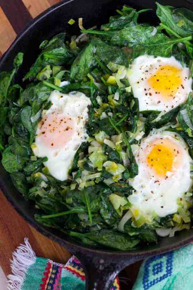 Skillet Poached Eggs with Spinach and Leeks. Quick and easy vegetarian dinner or brunch. #glutenfree