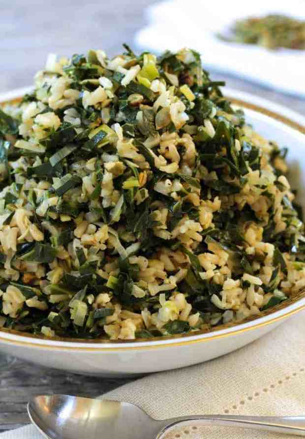 Dirty Rice with Collards and Leeks piled high in a bowl