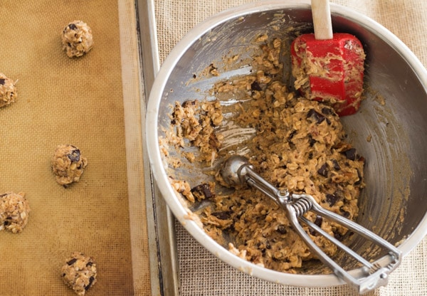 scooping gluten free Cowboy Cookies